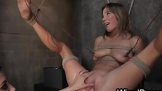 Tied up babe toying pussy with spread legs pussy deep fisted and ass wired and hard whipped