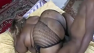 A black guy shakes the big ass of a fat woman