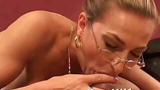 MILF with big tits giving a nice blowjob